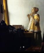 Женщина с жемчужным ожерельем - Вермеер, Ян